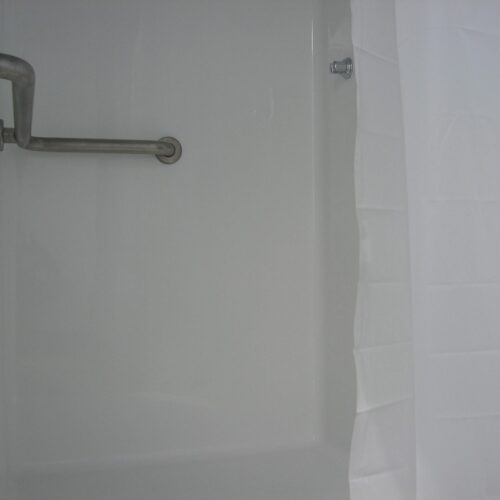 Each unit includes compliant shower stalls