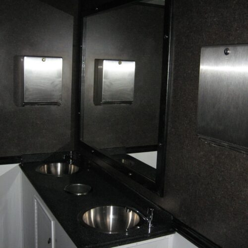 Double sinks provide ample room for cleaning up after using the facilities.