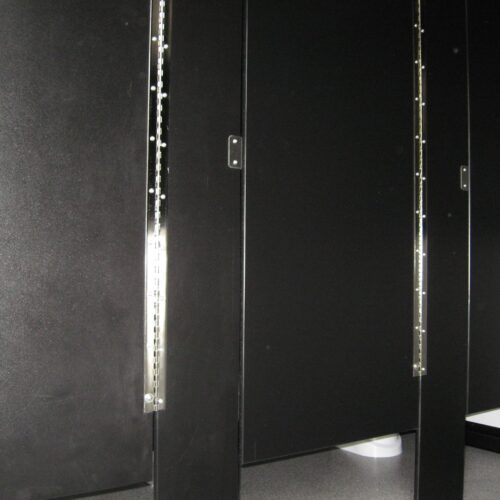 Each toilet stall has stylish, secure black and chrome fittings.