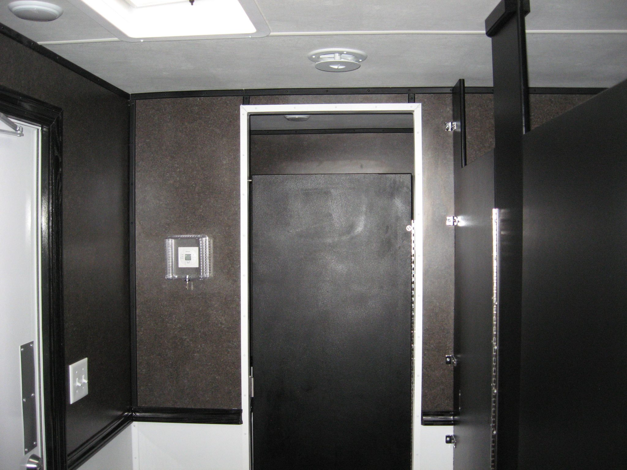This bathroom trailer has ample space to move people in and out.