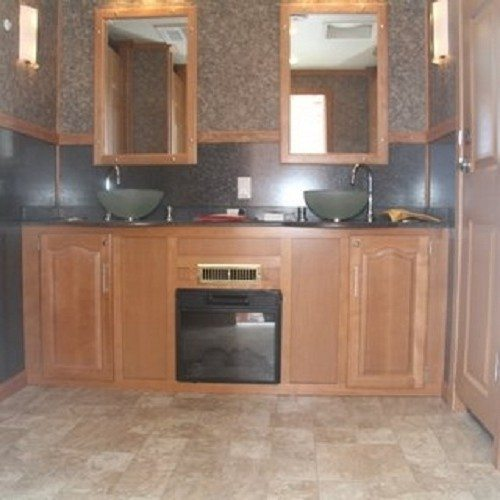 With a fireplace embedded below the sink this bathroom trailer is one to remember.