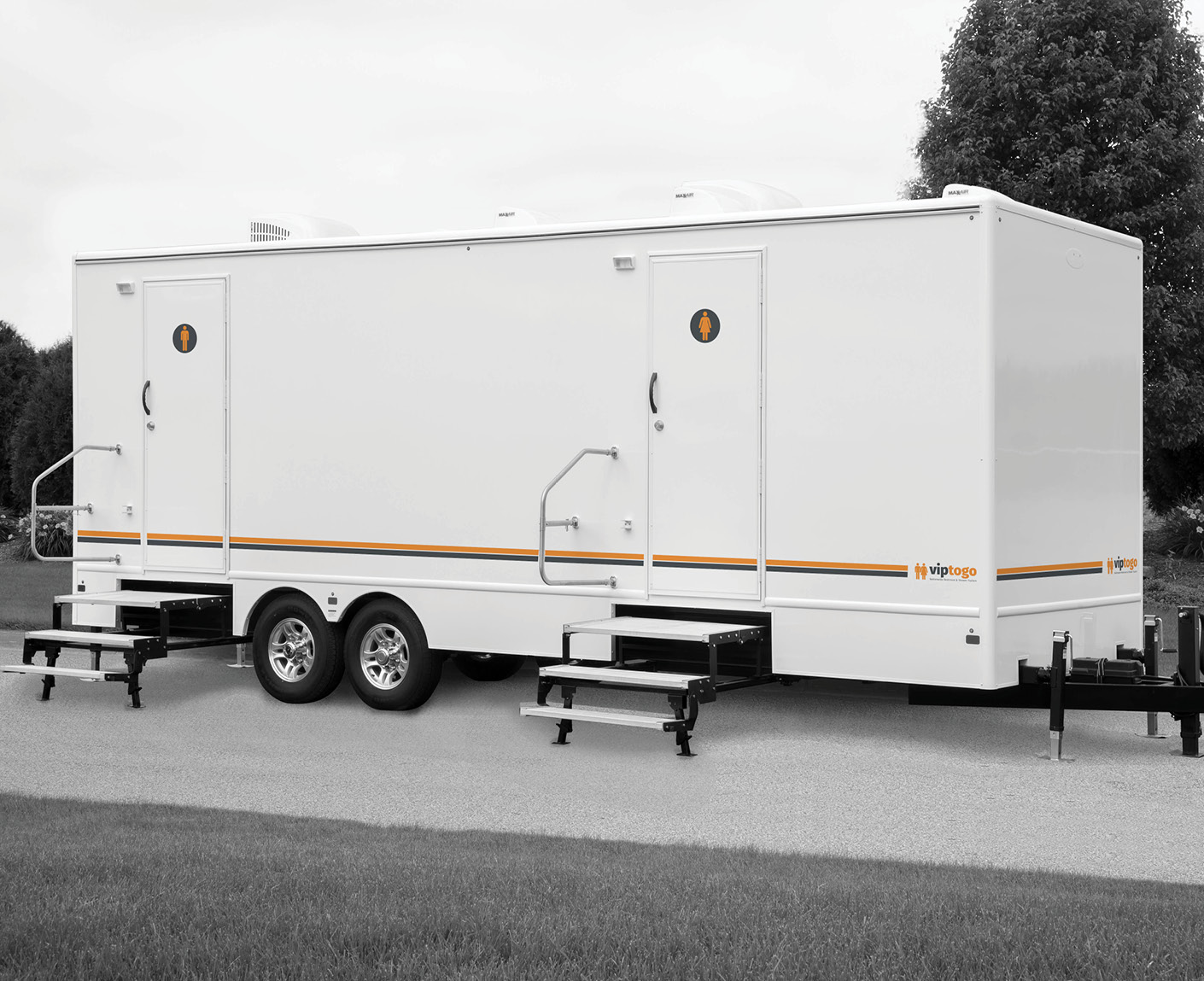 A front view of trailer booth with ten restrooms, and two doors with male and female sign on them
