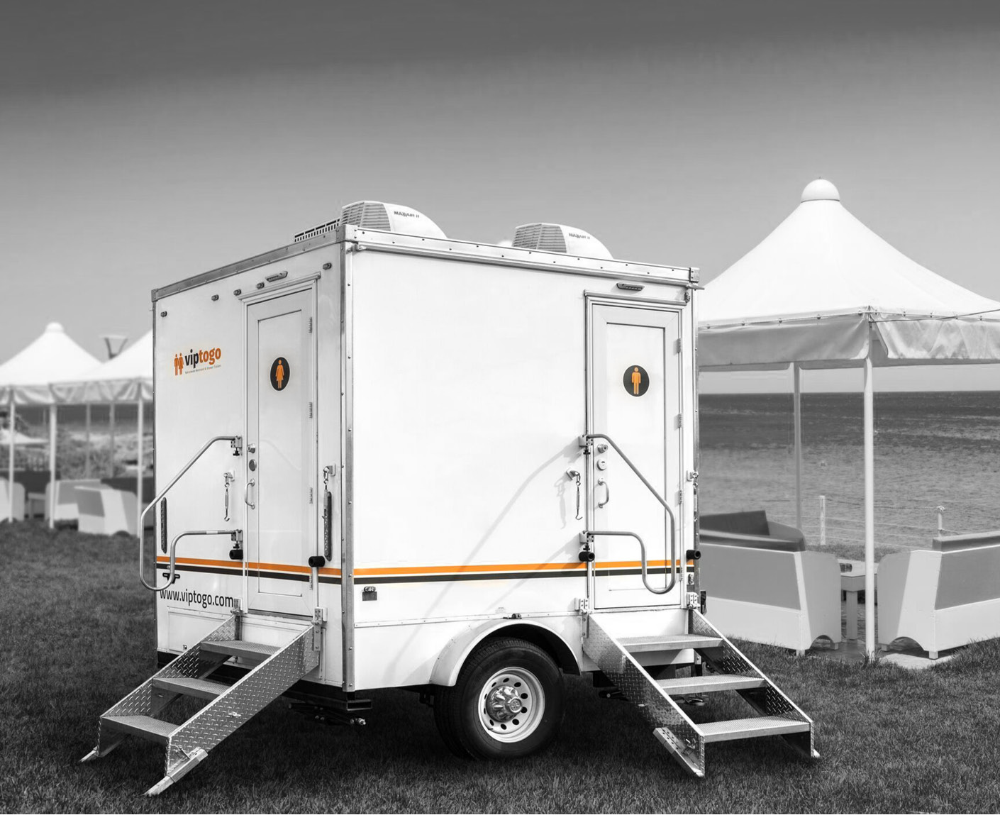 A mini restroom trailer with two separate stations and separate doors for males and females