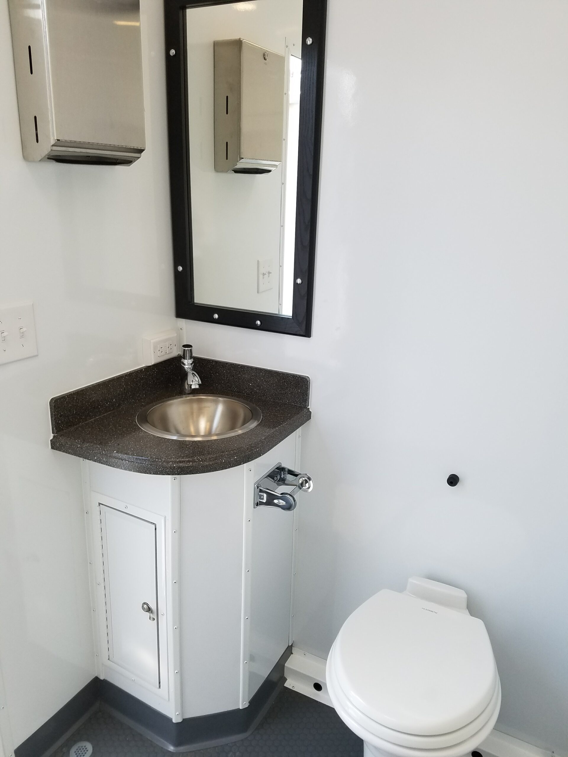 Inside view of 3 station restroom shower combo with one sink