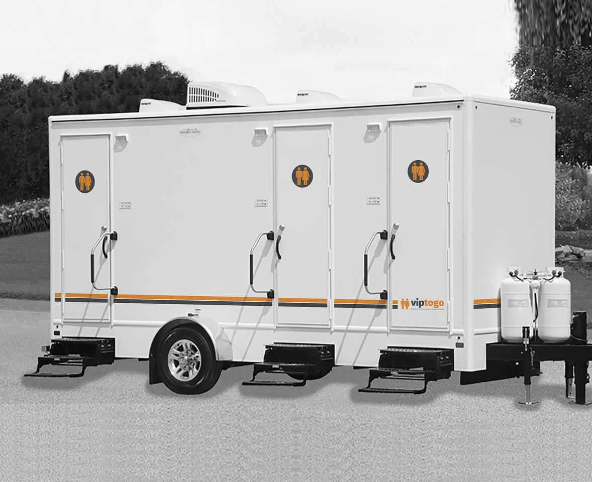 An outside image of the 3 station shower combo trailer
