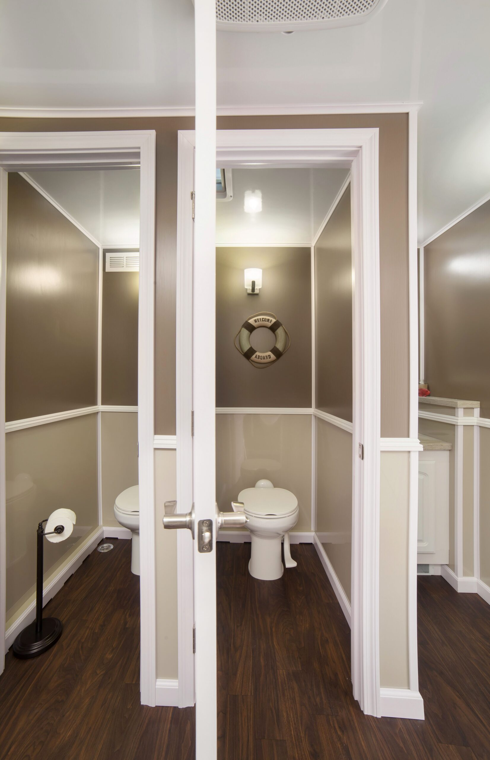 Inside look of two station restroom trailer where stalls are placed