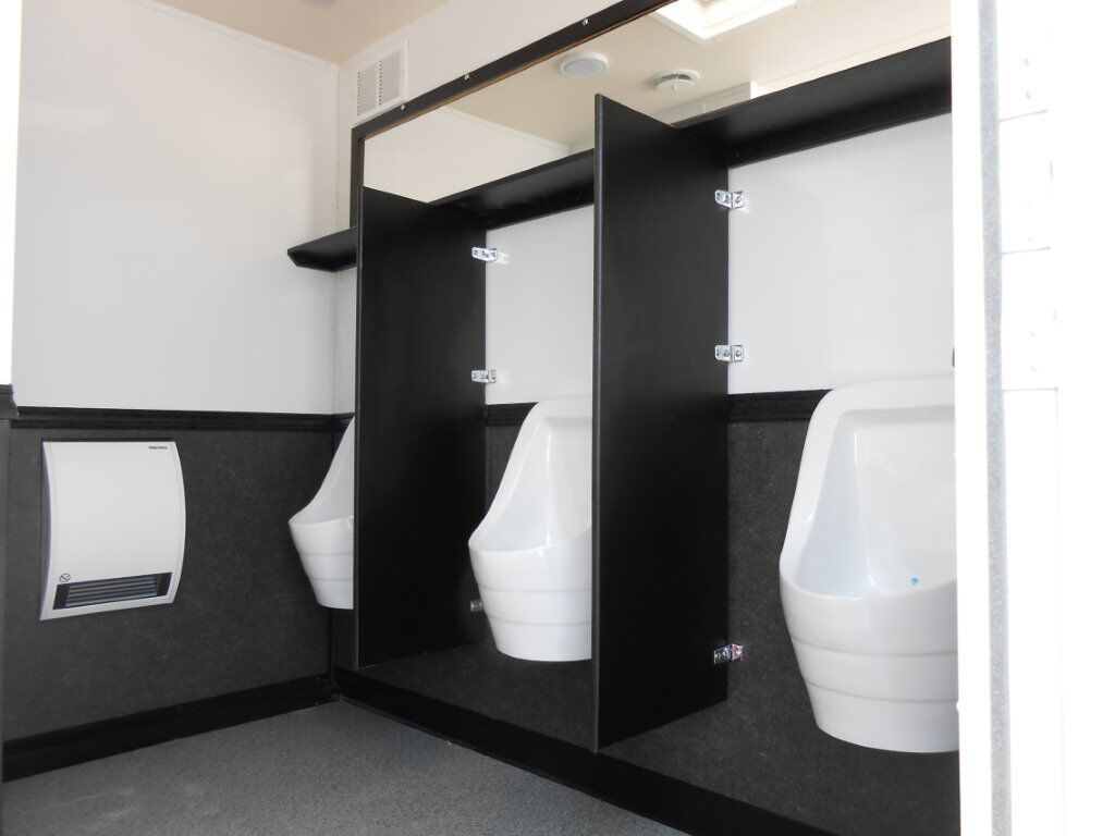 Side view of three urinals installed with separators in between them