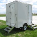 Two Station Stylish Restroom Trailer, at an Outdoor Party